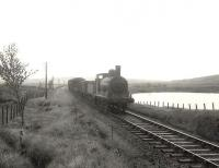 Ex-Caledonian 'Jumbo' 0-6-0 57362 approaching Loch Skerrow on 14 July 1956 with a Newton Stewart - Castle Douglas goods. <br><br>[G H Robin collection by courtesy of the Mitchell Library, Glasgow&nbsp;14/07/1956]