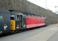 A Virgin CrossCountry service to Manchester Piccadilly awaits its departure time at Penzance platform 1 in June 2002. At the head of the train is 47812 <I>Pride of Eastleigh</I>.  <br><br>[Ian Dinmore&nbsp;01/06/2002]