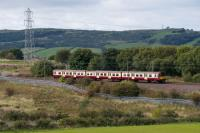 A 314 passes the site of Lyoncross Junction. The Barrhead and Paisley route was in the trees behind the train.<br><br>[Ewan Crawford&nbsp;14/09/2017]