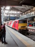 The unusual sight of a Class 91 hauling 'astern' has attracted a (very)<br> small crowd - unless they were just hanging about anyway. 91 127 is the<br> loco; presumably the one behind it had failed. The 1700 to London KX is the train, seen on 14 September.<br> <br> <br><br>[David Panton&nbsp;14/09/2017]