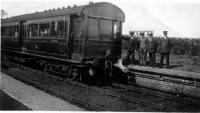 Ex-LNWR railmotor LMS No. 10698, paused (and posed) at Nateby whilst working a passenger service between Knott End and Garstang. Might this have been a <I>Last day of Service</I> photo? Services ceased on and from 31st March 1930 and Nateby closed completely although goods trains continued to pass through.  10698 was renumbered as 29988 in 1933 and became the last of its type in service running through the war until withdrawal in 1948. <br><br>[Knott End Collection&nbsp;29/03/1930]