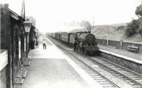 A parcels train runs through New Cumnock on 29 July 1961 behind <I>Crab</I> 2-6-0 42831.  <br><br>[G H Robin collection by courtesy of the Mitchell Library, Glasgow&nbsp;29/07/1961]