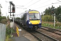 ScotRail 170477, forming the Sunday 1011 Edinburgh - Tweedbank service, about to arrive at the platform at Newcraighall on 17 September 2017. The freight line to Millerhill runs past on the right and the 'feathers' on the signal are for the Niddrie South - Niddrie West freight-only route.<br><br>[John Furnevel&nbsp;18/09/2017]