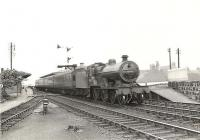 A Saturday St Enoch - Darvel train restarts from the Irvine stop on 4 July 1959. In charge is one of Hurlford shed's 2P 4-4-0s no 40645.<br><br>[G H Robin collection by courtesy of the Mitchell Library, Glasgow&nbsp;04/07/1959]