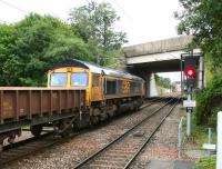 The 0740 (Sunday) Cambuslang - Millerhill ballast train runs south past Newcraighall station on 17 September 2017 behind GBRf 66741 <I>'Swanage Railway'</I>.<br><br>[John Furnevel&nbsp;17/09/2017]