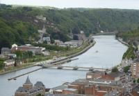 A view from the ramparts of Dinant Citadel, towards another castle on the far bank. A SNCB Class 08 Desiro EMU runs alongside the River Meuse as it approaches Dinant from Namur on 6th September 2017. The Meuse carries a significant amount of commercial and pleasure traffic and there are a succession of locks and weirs like the one seen here. <br><br>[Mark Bartlett&nbsp;06/09/2017]