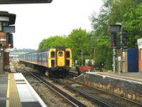 A train for Waterloo arriving at Woking platform 1 on 3 May 2002.<br><br>[Ian Dinmore&nbsp;03/05/2002]