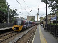 333004 leaves Saltaire station heading for Shipley and Bradford Forster Square on 23rd September 2017. In the background is the famous Salts Mill, centrepiece of the village. Is there another UK station that has <I>World Heritage Site</I> on it's platform signs?<br><br>[Mark Bartlett&nbsp;23/09/2017]