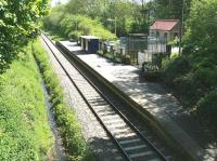 High noon at Kildale on the Middlesbrough - Whitby line on sunny 3 June 2013. View is east from the footbridge looking towards Grosmont. [Ref query 4 October 2017]<br><br>[John Furnevel&nbsp;03/06/2013]
