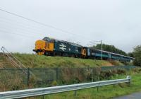 37403 <I>Isle of Mull</I> accelerates away from the Lancaster stop and is seen approaching Morecambe South Junction with 2C47, the Preston to Barrow-in-Furness service on 21st September 2017. <br><br>[Mark Bartlett&nbsp;21/09/2017]