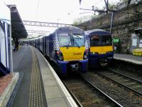 Edinburgh (left) and Balloch services cross at High Street on 19 September 2017.<br> <br> <br><br>[David Panton&nbsp;19/09/2017]
