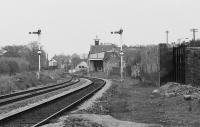 Looking west from the station platforms to Elgin West signalbox in 1991. These semaphores and the other mechanical signalling apparatus at Elgin are scheduled to be abolished in October 2017.<br> <br> <br><br>[Bill Roberton&nbsp;//1991]