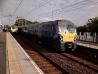Milngavie (right) and Edinburgh services pass at Uphall on 25th September 2017. Unusually the Edinburgh train is only formed of three coaches so I've now got to leg it!<br> <br><br>[David Panton&nbsp;25/09/2017]