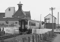 156494 passes Elgin West signalbox with an Inverness service in 1991. The signalbox will be abolished and associated signalling replaced in October 2017 but the Sprinter remains in Scotrail service working out of Corkerhill.<br> <br> <br><br>[Bill Roberton&nbsp;//1991]