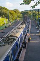 Passengers board a northbound 380 in bright evening light.<br><br>[Ewan Crawford&nbsp;14/09/2017]