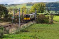 The rural nature of the last few miles of the Neilston branch are obvious in the view. 314 206 is heading for Glasgow passing the site of Netherton Goods, which was on the left.<br><br>[Ewan Crawford&nbsp;28/09/2017]