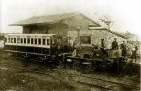 An old grainy photo showing the first locomotive of the Garstang & Knot End Railway at Garstang Town around 1871. This was <I>Hebe</I>, a Manning Wardle 0-4-2ST and when the line opened in December 1870 it was their only locomotive. After more than a year of continuous use it broke down, leading to financial problems for the G&KER and <I>Hebe</I> being repossessed. The line closed in 1872 but reopened in 1875 with two new locomotives, Manning Wardle 0-4-0ST <I>Union</I> and Hudswell Clarke 0-6-0ST <I>Farmers Friend</I>, which had a piercing whistle and became unofficially known as <I>The Pilling Pig</I>. Garstang station was later rebuilt as an island platform.<br><br>[Knott End Collection&nbsp;//1871]