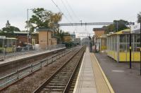 A view east along platform 3 at Huyton with work continuing to reinstate platform 4 on the left. During the first week of the Liverpool Lime Street closure (starting on 30 September) commissioning of the 4th track and platform is scheduled to take place now that extra land has been obtained next to the building on the left in the background.<br><br>[John McIntyre&nbsp;26/09/2017]