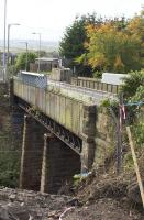 Only now revealed from this angle during the preparatory works for its replacement, the Muirhead Road overbridge at Baillieston station seen in October 2017. <br><br>[Colin McDonald&nbsp;10/10/2017]
