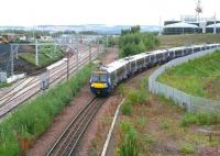 ScotRail 170461 approaching the Newcraighall stop on Sunday 24 September 2017 with the 0845 Tweedbank - Edinburgh. Work on the new EGIP electric train depot continues in the left background - as it does on the new Edinburgh and Midlothian Recycling and Energy Recovery Centre in the right background<br><br>[John Furnevel&nbsp;24/09/2017]