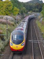 The 12.52 Edinburgh - London Euston nears the former Ravelrig Junction on 30th September 2017. In the background is Dalmahoy Hill.<br> <br> <br><br>[Bill Roberton&nbsp;30/09/2017]