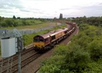 DB Cargo train 483K from Birch Coppice (a GBRf facility) to London Gateway about to pass over the West Coast Main Line at Nuneaton hauled by DBS 66034.<br><br>[Ken Strachan&nbsp;12/06/2017]