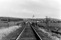 A view eastwards towards the WCML from just outside Garstang Town station before final closure. In the foreground is the bridge over the River Wyre. This was demolished after closure but later another bridge was built in connection with water treatment and flood control facilities. [See image 28295] for a similar but 21st Century view. <br><br>[Knott End Collection&nbsp;//]