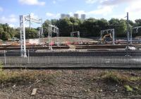 Grabshot from a passing train of the progress of the electrification work in early October 2017. The previous day there were dozens of contractor's staff in orange overalls working on the OHLE in the autumn sunshine.<br><br>[Colin McDonald&nbsp;05/10/2017]