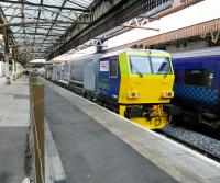 The leaves on the line are safe for the time being as the leafblaster takes<br> a break at Platform 6 in Perth. Six has no scheduled (or perhaps unscheduled)<br> passenger use.<br> <br> <br><br>[David Panton&nbsp;04/10/2017]