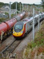 The 10.51 Edinburgh - Euston joins the WCML at Carstairs South Junction, passing 70804 heading north with the Dalston - Grangemouth empty tanks. 3rd October 2017.<br> <br> <br><br>[Bill Roberton&nbsp;03/10/2017]