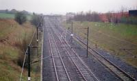 Looking south to Glengarnock station in 1997. The Lanarkshire and Ayrshire crossed over here on its route to Kilbirnie, which also served the Glengarnock Iron and Steel Works. By this date, the embankments on both sides had been largely eradicated although some hedge lines gave away where they had run. The siding to the right ran ahead to the goods yard, iron and steelworks. By 1997 it served a shed in the goods yard and ran for a very short length toward the former works having been cut back a few years before.<br><br>[Ewan Crawford&nbsp;//1997]