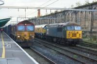 66111 pauses at Carlisle whilst working a Daventry to Grangemouth container train on 7th October 2017. In the sidings on the right 56303 is stabled with a rail grinder.<br><br>[John McIntyre&nbsp;07/10/2017]