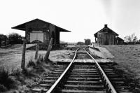 A view of Garstang Town station, probably from the early 1960s. The distinctive narrow station building with the slightly wider signal box at the far end [See image 61091] is on the island platform, which in passenger carrying days was accessed by a footbridge. Beyond and to the right is the old GKER engine shed, later dismantled and rebuilt nearby as a farm building. Straight ahead is the water tower with the small goods shed on the left. Final closure came in 1965 and the site is now covered by a housing development known as Station Way.  <br><br>[Knott End Collection&nbsp;//]