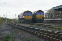 A pair of EWS Class 66s sit in the sidings next to Didcot station on 30 October 2010 waiting for their next working. [Ref query 21 October 2017]<br><br>[John McIntyre 30/10/2010]
