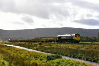 Freightliner liveried 66524 leads a train of loaded ballast wagons for Inverness at Moy on 10th October 2017. 66545 was bringing up the rear.<br> <br> <br><br>[John Gray&nbsp;10/10/2017]