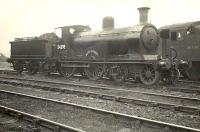 Built by Dubs & Co in 1898, Drummond <I>'Small Ben'</I> 4-4-0 no 54398 <I>Ben Alder</I>, stands on shed at St Rollox in November 1950. The historic ex-Highland Railway locomotive, the last of its class, was stored  for some time following withdrawal with a view to preservation. Sadly this was not to be. [See image 36646] <br><br>[G H Robin collection by courtesy of the Mitchell Library, Glasgow&nbsp;01/11/1950]