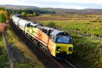 Colas Rail liveried 70814 climbs the gradient out of Tomatin with thirteen Tarmac cement tankers for Inverness. 12th October 2017.<br> <br> <br><br>[John Gray&nbsp;12/10/2017]