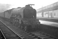 A foggy day at Carlisle three days before Christmas in 1962. View back towards bay platform 7, with the 1.40pm to Edinburgh Waverley via Hawick awaiting its departire time. Locomotive in charge is A3 Pacific 60097 <I>Humorist</I>. <br><br>[K A Gray&nbsp;22/12/1962]