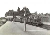 Scene at Ayr station on 25 July 1960. A Glasgow bound DMU calls at platform 3, while a Kilmarnock train waits in bay platform 1. The locomotive is Hurlford 2P 4-4-0 40642. <br><br>[G H Robin collection by courtesy of the Mitchell Library, Glasgow&nbsp;25/07/1960]