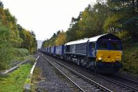 66424 ascends the gradient from Findhorn Viaduct and enters the loop at the closed station of Tomatin on 12th October 2017 with a full load of curtainside containers heading for Inverness.<br> <br> <br><br>[John Gray&nbsp;12/10/2017]