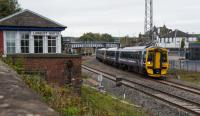 View south to Larbert showing electrification masts between the platforms, the old station building above the train and signal box to left.<br><br>[Ewan Crawford&nbsp;08/10/2017]