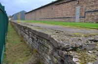 The old WW2 food store at Innerleithen, and its loading platform, a little to the west of Innerleithen Station.  This is alongside the Tweed Valley Way on 15th October 2017.<br> <br> <br><br>[Bill Roberton&nbsp;15/10/2017]