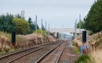 View east from the east end of Breich station showing masts. These have been erected approaching both sides of the station, but not through it,<br><br>[Ewan Crawford 08/10/2017]
