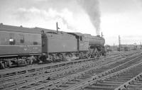 The 1.40pm Stranraer Harbour - Newcastle Central pulls away from Carlisle on 13 July 1963 behind V2 2-6-2 60975.<br><br>[K A Gray&nbsp;13/07/1963]