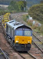 DRS 66424 passes Inverkeithing East Junction with a Barnhill - Millerhill train of recovered track panels on 14th October 2017.  The Perth - Dundee line was closed for track renewals. <br> <br> <br><br>[Bill Roberton&nbsp;14/10/2017]