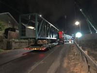 The sections of the Baillieston temporary pedestrian and services bridge together with its north supporting tower have arrived at the site and are waiting for OHLE isolation and the start of the possession before lifting commences.<br><br>[Colin McDonald&nbsp;29/10/2017]