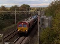 Train 384E, topped and tailed by DB 66's, is an RHTT from Bescot TMD to Euston. It was seven minutes early as it sprayed its way towards Hanslope Junction after passing through Northampton station and over the M1.<br><br>[Ken Strachan&nbsp;13/10/2017]