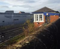 A contrast of old (the signal box) and new (the Network Rail Training Centre) at Larbert. The view looks north just north of the station.<br><br>[John Yellowlees&nbsp;17/10/2017]