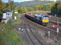 DRS 66303 passes Stirling North signal box with an empty ballast to Millerhill.  The main line was blocked at Cornton a little to the north for EGIP work, with Alloa branch (on the right) services unaffected.<br><br>[Bill Roberton&nbsp;22/10/2017]
