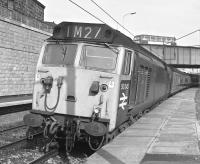 On Saturday 4th of May 1974, the last day of Class 50 hauled services to London Euston from Glasgow before the electric hauled Class 87s, 50045 is seen at Motherwell. A Central SMT Lodekka bus is on the overbridge ... and no, I didn't get the driver to adjust tops to suit me (IM)!<br><br>[Ian Millar&nbsp;04/05/1974]